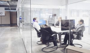 Meeting in a glass room - photography by BrandCraft Marketing