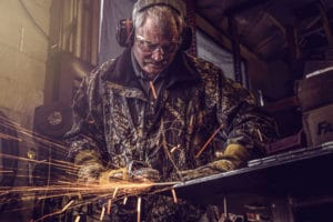 Man using an angle grinder - photo by BrandCraft Marketing