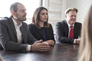Gravis law attorneys in a meeting